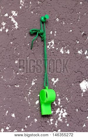 picture of a green referee whistle, sport theme