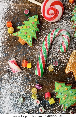 Christmas Cookies In The Shape Of Tree, Cane And Candy Strewn With Snow