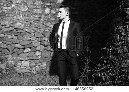 Elegant Man Poses Outdoor