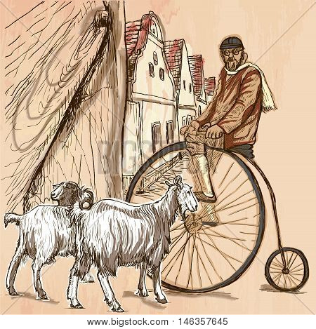 BICYCLIST.Cyclist on the velocipede posing at the old village. In front of old houses are also two goats.Freehand sketching line drawing. An hand drawn vector illustration.Colored line art technique.