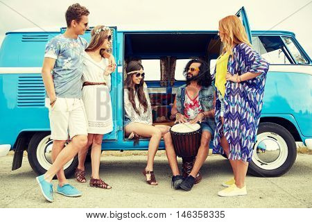 summer holidays, road trip, vacation, travel and people concept - happy young hippie friends with tom-tom drum playing music over minivan car