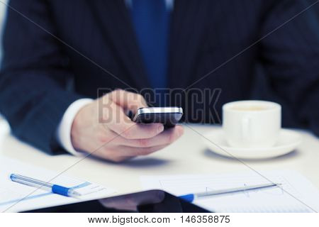 business, technology and interent concept - businessman with smartphone reading news
