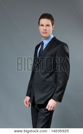 Young businessman wearing classic dark suit