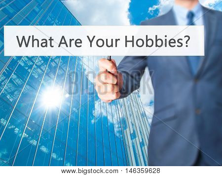 What Are Your Hobbies ? - Businessman Hand Holding Sign