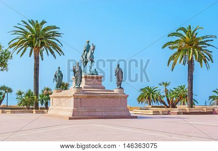 The equestrian statue of Napoleon surrounded by his four brothers in Roman garb located in Place de Gaulle Ajaccio Corsica France.