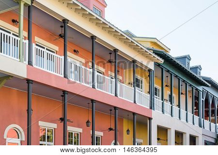 Many Fans on Many Brightly Colorful Balconies