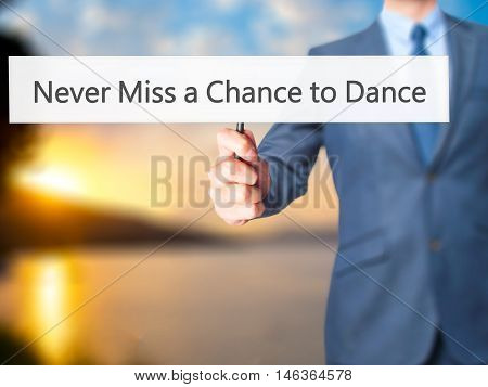 Never Miss A Chance To Dance - Businessman Hand Holding Sign