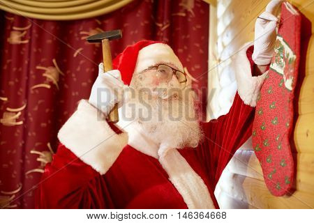 Santa Claus hanging Christmas stocking