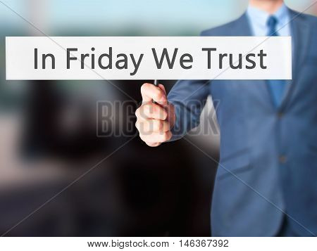 In Friday We Trust - Businessman Hand Holding Sign