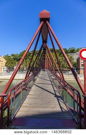 View Of Red Footbridge In Lyon With Saone River,france