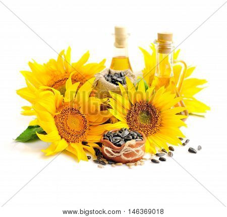 Yellow Sunflowers With Bottles Of Oil And A Small Bag Of Seeds On A White Background