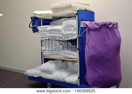 fresh linen for the hotel room on floor Cart