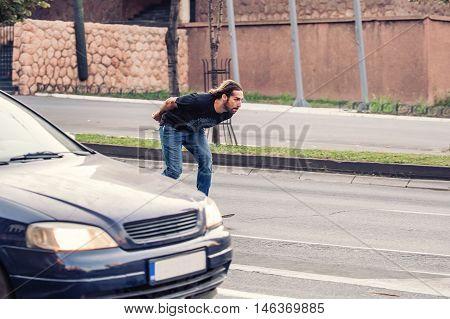 Skateboarder Riding A Skateboard Slope On The City Streets