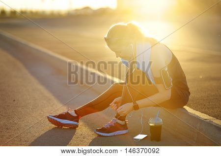 Sporty Runner Woman Tying Laces Before Training.