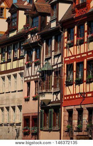 Houses with flowers at windows. Nuremberg Bavaria Germany