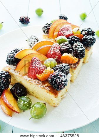 Sponge cake with berries and fruits. Shallow dof.