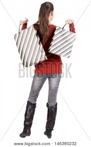 back view of going  woman  in  sweater woman with shopping bags . beautiful brunette girl in motion.  backside view of person.  Rear view people collection. Isolated over white background.