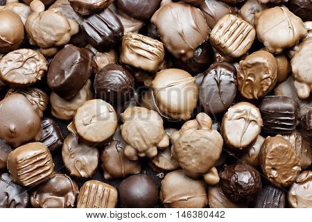 Background of a variety of milk and dark chocolate candies.