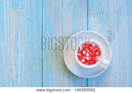 Coffee Cup Full Of Candies Flat Lay On Rustic Light Blue Wooden Background
