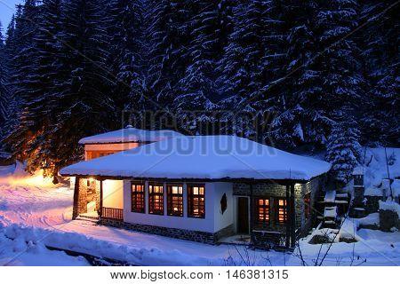 beautifull small hut evening in winter mountain