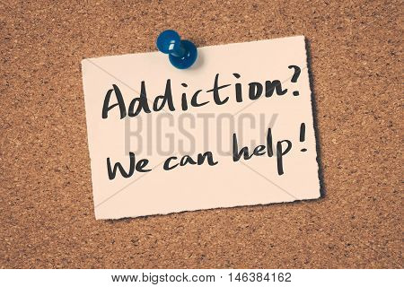 Addiction? We can help! note pin on the bulletin board