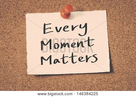 Every moment matters note pin on the bulletin board