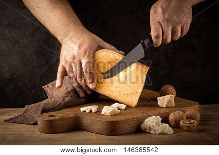 cheese cut with a knife on a wooden board