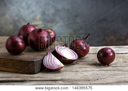 red onions on a wooden board. still life