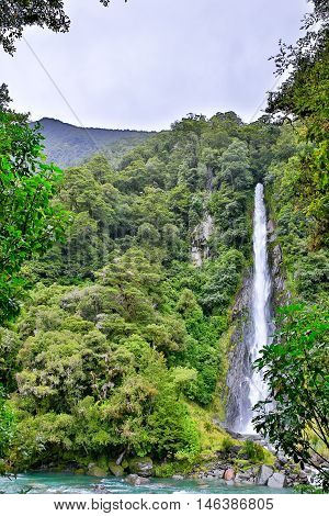 Waterfall In The Forest In Westland National Park, New Zealand