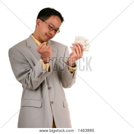 Confused Handcuffed Biz Man Holding Money 4