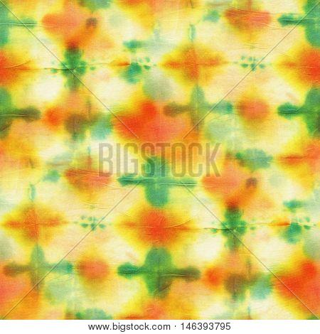Seamless tie-dye pattern of red and green color on white silk. Hand painting fabrics - nodular batik. Shibori dyeing.
