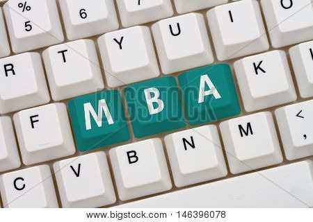Getting your MBA online A close-up of a keyboard with teal highlighted text MBA