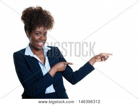 African american business woman pointing sideways on an isolated white background for cut out