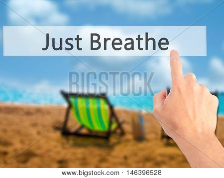 Just Breathe - Hand Pressing A Button On Blurred Background Concept On Visual Screen.