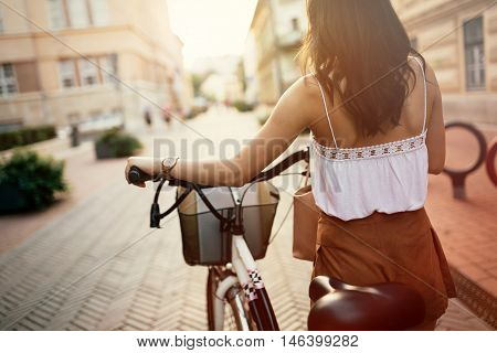 Tourist woman using bicycle as means of transportation