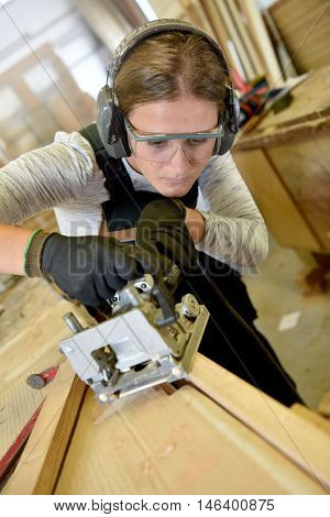 Young woman in woodwork training course