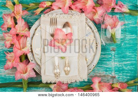 Tableware And Silverware With Gladiolus
