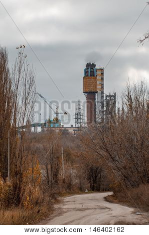 Old rusty urea granulation tower. Industrial zone. Ukraine