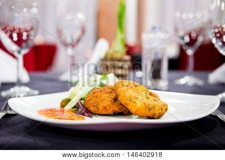 Romantic dinner - lovely plate of fishcakes in a stylish restaurant