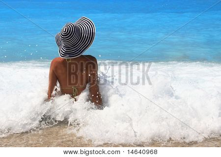 Pretty blonde woman enjoying the Ionian sea in Greece