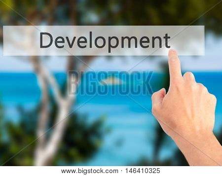 Development - Hand Pressing A Button On Blurred Background Concept On Visual Screen.