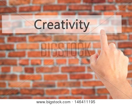 Creativity - Hand Pressing A Button On Blurred Background Concept On Visual Screen.