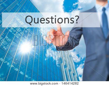 Questions ? -  Businessman Press On Digital Screen.