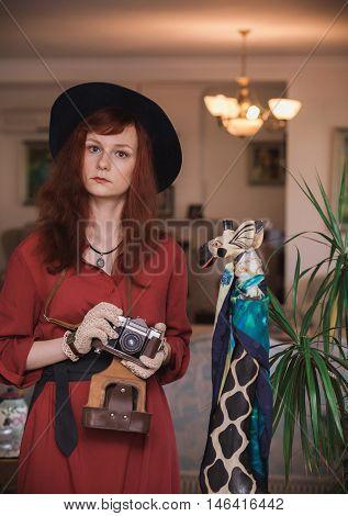 Model In Vintage Costume Wıth Old Camera