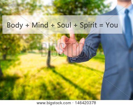 Body + Mind + Soul + Spirit = You -  Businessman Press On Digital Screen.