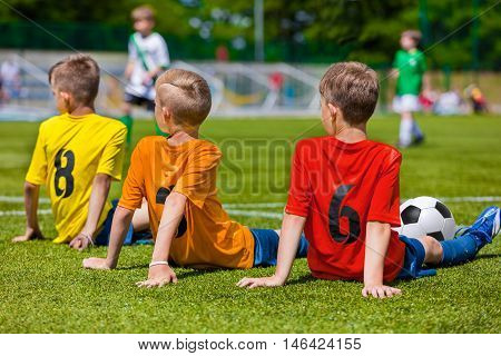 Boys of sports team waiting for soccer game. Youth football team during school sport tournament