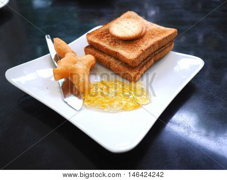 Breakfast with deep-fried dough stick or Patongko with Sweetened condensed milk and toast with marmalade jam
