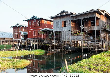 Traditional floating houses and floating gardens at Inle Lake area Myanmar Asia