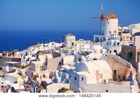 Day panorama of Oia Santorini with the famous windmill. Horizontal shot