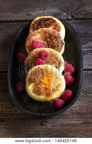 Cottage Cheese Pancakes With Raspberries On Old Iron Pan.